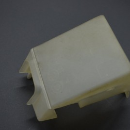 OEM battery positive terminal cover.