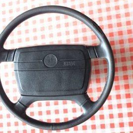 Fine spline airbagged steering wheel