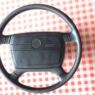 Fine spline airbagged steering wheel