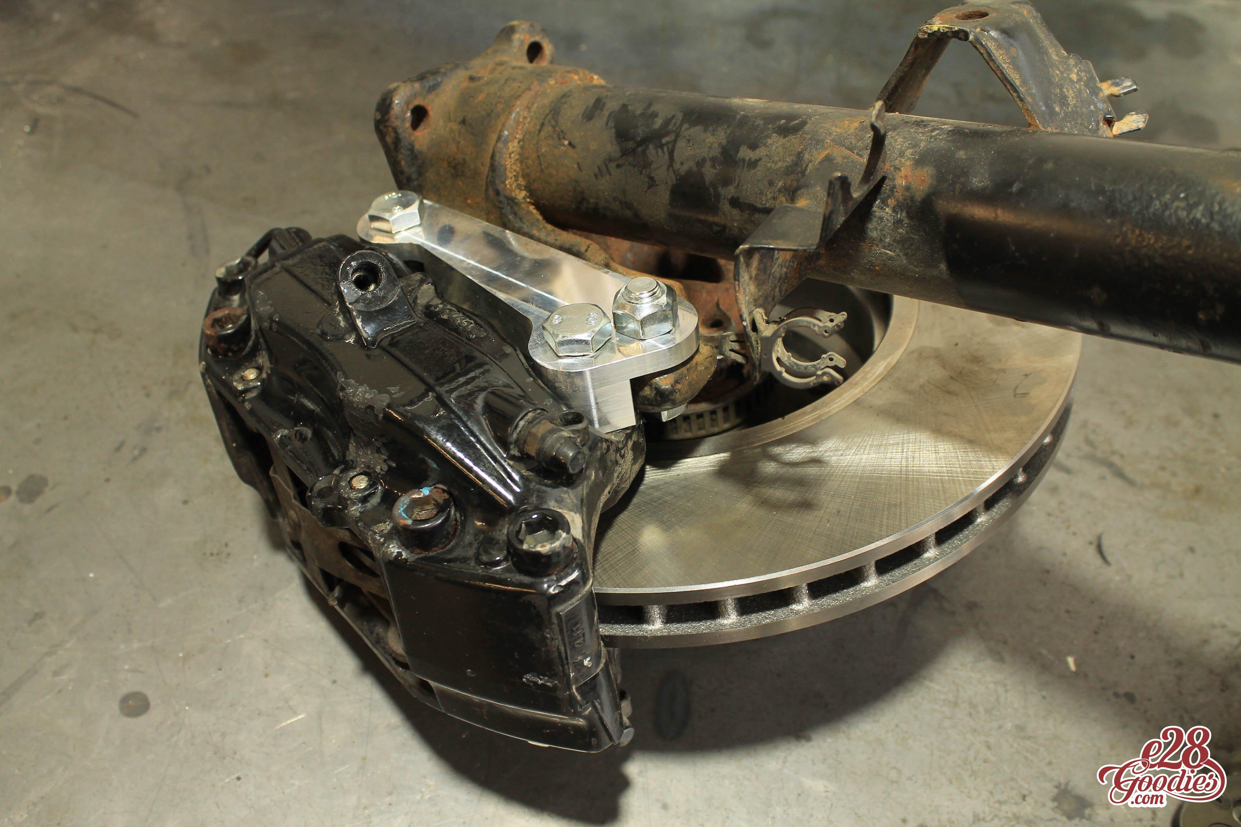 e38 Four pot brembo caliper adapters for your e34